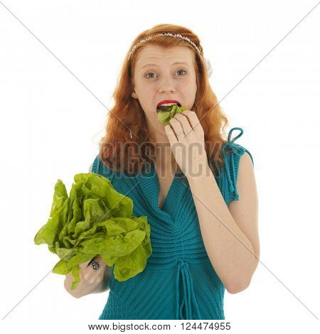 Young woman eating lettuce for diet isolated over white background