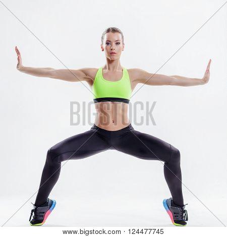 beautiful fitness female posing on studio background