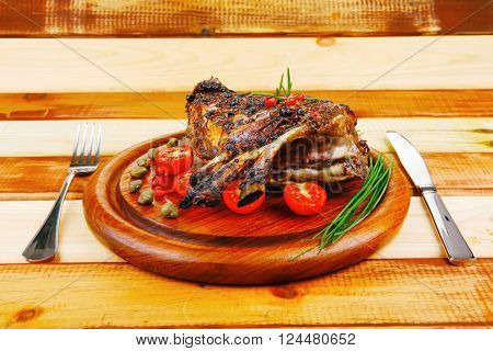 ribs rack on wood with stainless steel cutlery