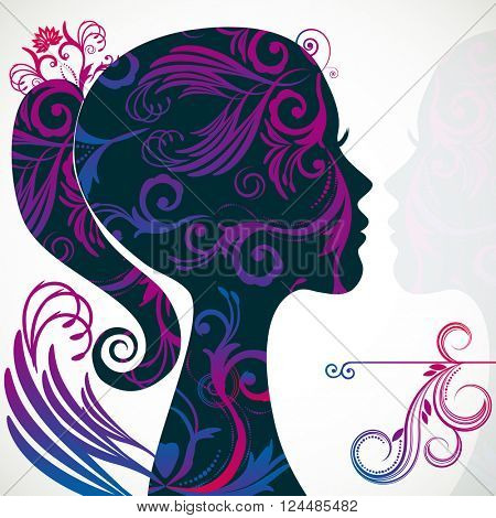 Profile of beautiful young woman decorated with floral patterns.