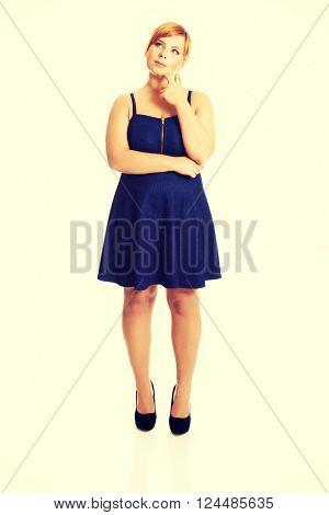 Thoughtful plus size woman