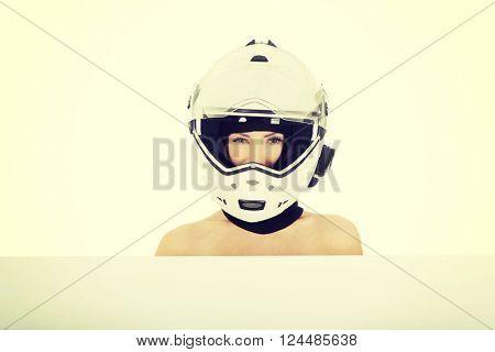 Woman in motorcycle helmet.