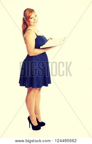 Overweight woman holding a book