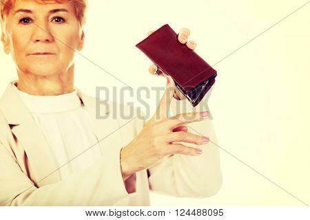 Worried elderly woman with empty wallet