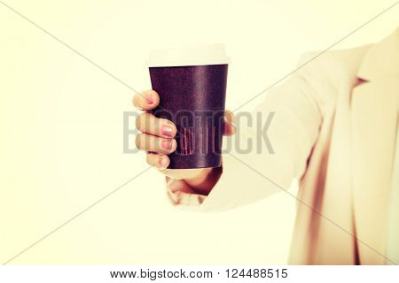 Elderly woman holding paper cup