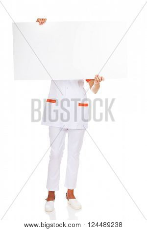 Female doctor or nurse  holding empty banner