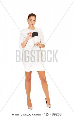 Young businesswoman holding small empty advertising board