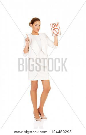 Young businesswoman holding a board with ban