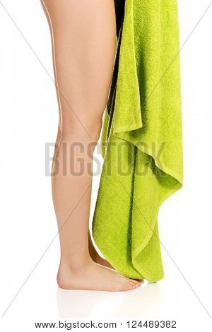 Young woman legs with green towel.
