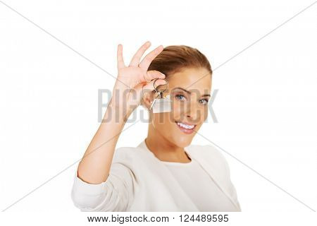 Young businesswoman holding house keys
