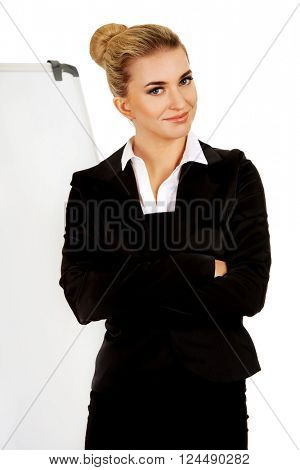 Young business woman standing nex to the white board