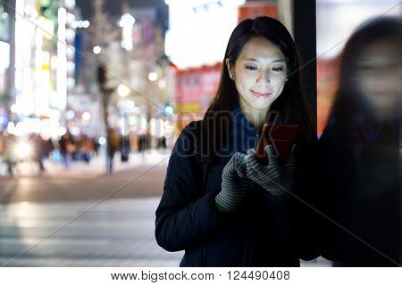 Woman use of mobile phone at street