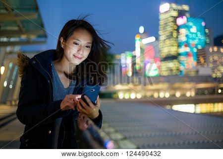 Woman use of mobile phone at Hong Kong