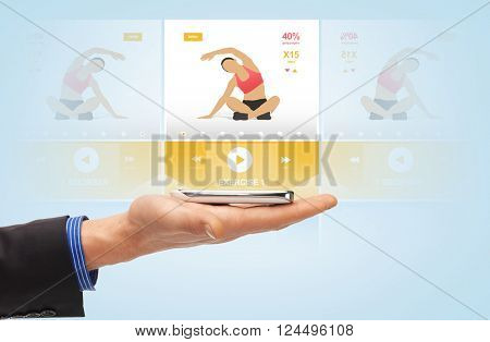 people, technology, sport and fitness concept - close up of male hand with smartphone and sports application projection