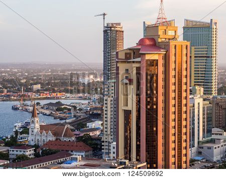 DAR ES SALAAM TANZANIA - JUNE 08 2015: Architecture in downtown of Dar es Salaam Tanzania East Africa in the evening at sunset. Horizontal orientation.