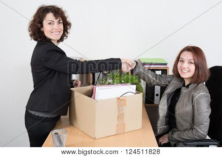 Female Corporate Supervisor Sking Hands To An Employee  She Is About To Be Made Redundant