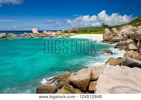 Seychelles island landscape, rocks, turquise sea, clouds, blue sky.