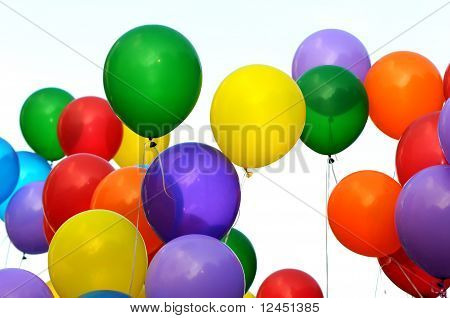 group of multicolored balloons in the city festival poster