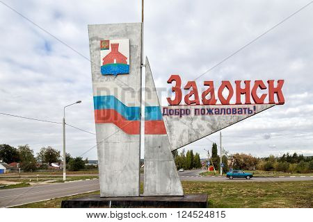 Zadonsk, Russia - October 9, 2015: Stele at entrance to Zadonsk. It contains the name and emblem of city