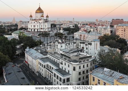 Christ the Savior Cathedral and roofs of buildings at evening in Moscow