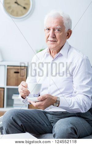 Older Man And Tea Time