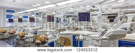 Modern dentistry classroom with new technology phantoms for students to practice poster