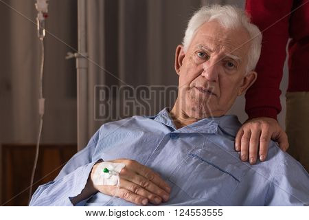 Image of incurable ill senior man having care