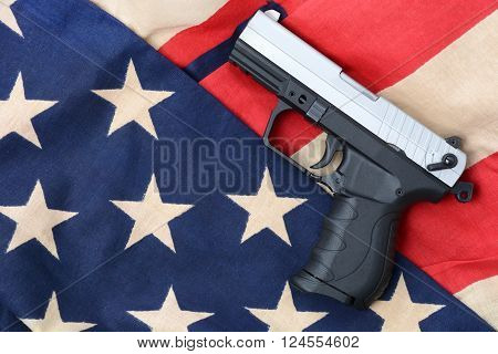 gun laying on a american flag concept