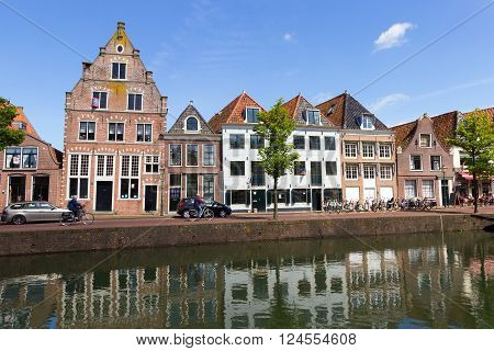 HOORN NETHERLANDS - MAY 15, 2014: Row of canal houses along a canal in Hoorn. The City is founded in 716 and was an important VOC home base.