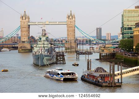 LONDON - JUL 1 2015: View on the Tower Bridge and HMS Belfast in London.