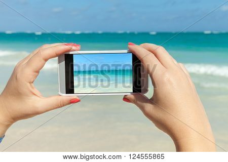 Woman Holds Phone In Hands For Taking Photo