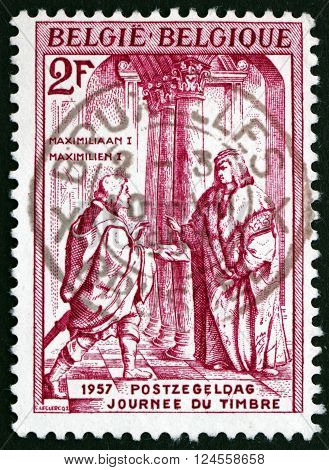 BELGIUM - CIRCA 1957: a stamp printed in the Belgium shows Emperor Maximilian I Receiving Letter Day of the Stamp circa 1957