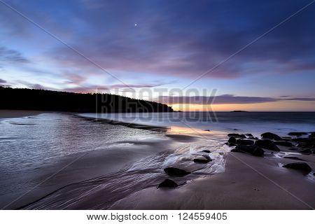 Colorful sunrise along New England coast - Sand Beach, Acadia National Park, Maine