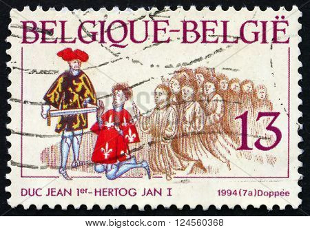 BELGIUM - CIRCA 1994: a stamp printed in the Belgium shows Reconciliation between John I and Arnold Squire of Wezemaal Scene from Brabantse Yeesten 15th Century Illuminated Manuscript circa 1994