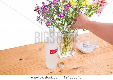 Add Vodka And Sugar Into Vase To Keep Flowers Fresher