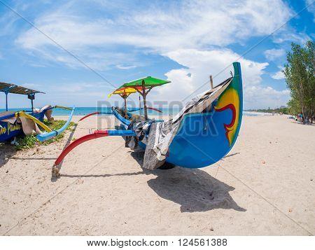 KUTA BALI - INDONESIA, JULY 20 : Traditional dragonfly fishing boat on the beach in  Kuta Bali Indonesia July 20th, 2015