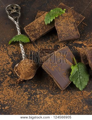 Pieces Of Dark Chocolate, Mint And Cocoa Powder