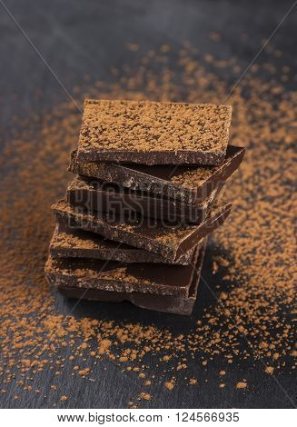 Pieces Of Dark Chocolate And Cocoa Powder