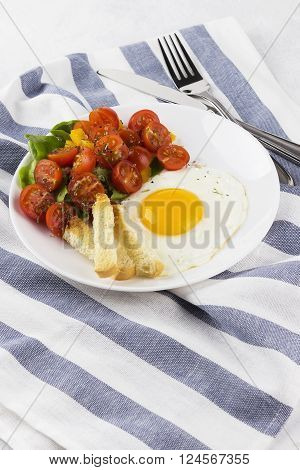 Breakfast: Fried Eggs With Tomatoes And Pepper On A White Background