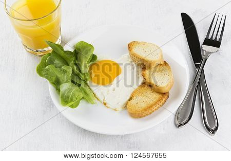 Breakfast: Fried Eggs With Greens, Orange Juice On A White Background