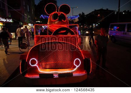 ANKARA/TURKEY - JUNE 20, 2008 : Mickey Mouse in the car at the torchlight procession of carnaval.  June 20, 2008-Ankara/Turkey