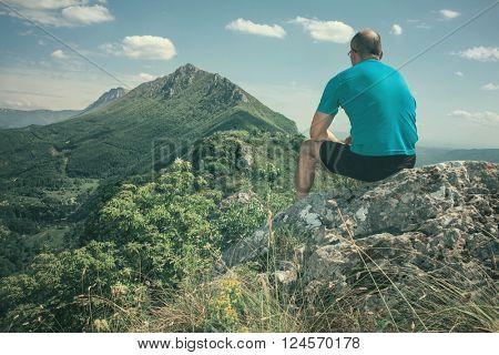 Active sport man resting and enjoying nature