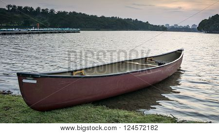 Putrajaya Malaysia March 2 2016; View of sunset on the lake Watland very beautiful with a boat and kayak on the lake shore.