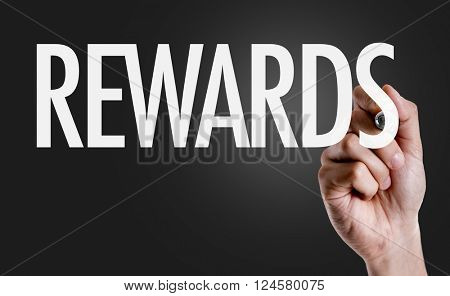 Hand writing the text: Rewards