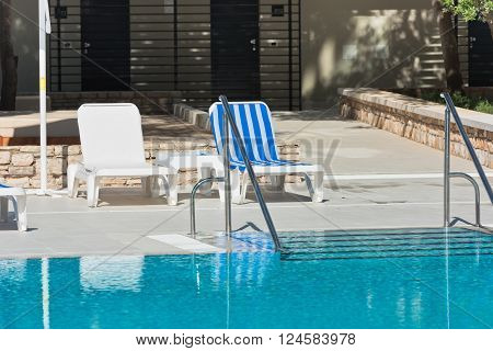 Hotel Poolside Chairs Near A Swimming Pool