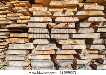 Stack Of Rough Wooden Boards In Lumberyard