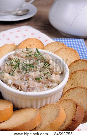Appetizer of fish paste (forshmak ) with slices of dried baguette