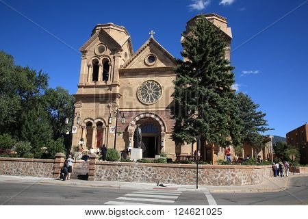 SANTA FE, NEW MEXICO - SEPTEMBER 23: Tourists and sightseers crowd the Basilica Of St. Francis Of Assisi on September 23, 2010 in Santa Fe, New Mexico. The Santa Fe landmark was built in the 1800's.