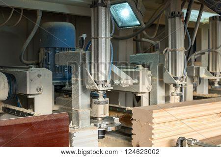 Sawmill. Close-up of shaped timber cutting on machine