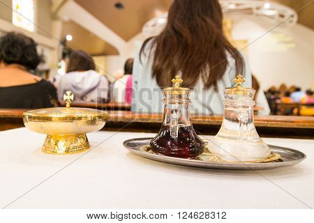Catholics Bread And Wine In Chalice With De-focused Background